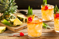 Homemade Mai Tai Cocktail. With Pineapple Cherry and Rum royalty free stock photos