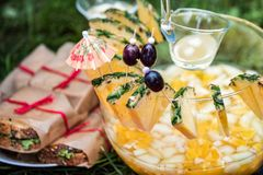 Homemade Mai Tai Cocktail with umbrella. Smoothies from pineapple and olives in glass. Cocktail with pineapple and ice served cold Royalty Free Stock Image