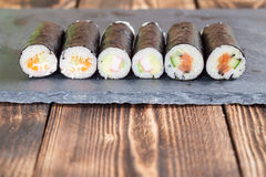 Homemade maki sushi rolls. On a slate board royalty free stock photos