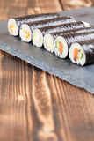 Homemade maki sushi rolls. On a slate board Royalty Free Stock Photography