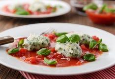 Homemade malfatti with tomato sauce Royalty Free Stock Image