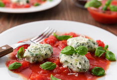 Homemade malfatti with tomato sauce. Italian dish of spinach, flour and cheese Royalty Free Stock Images