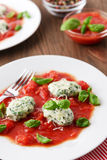Homemade malfatti with tomato sauce. Italian dish of spinach, flour and cheese Stock Image