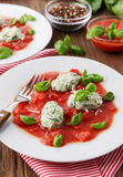 Homemade malfatti with tomato sauce. Italian dish of spinach, flour and cheese Stock Photos