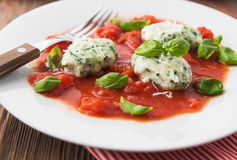 Homemade malfatti with tomato sauce. Italian dish of spinach, flour and cheese Royalty Free Stock Image