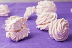 Homemade marshmallow on a purple background. Toned. Stock Photography