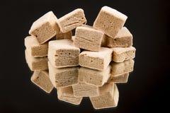 Homemade marshmallows on black backgrouns. Royalty Free Stock Photos