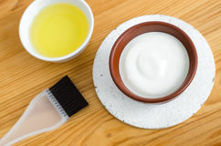 Homemade mask made of sour cream greek yogurt and olive oil. Diy cosmetics. Homemade mask made of sour cream greek yogurt and olive oil Royalty Free Stock Photography