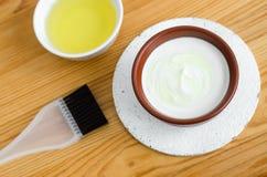 Homemade mask made of sour cream greek yogurt and olive oil. Diy cosmetics. Homemade mask made of sour cream greek yogurt and olive oil Stock Images