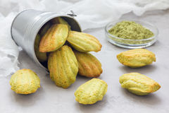 Homemade matcha green tea madeleines on the table and in metal bucket Royalty Free Stock Images