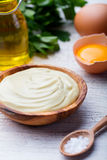 Homemade mayonnaise, mayo in a wooden bowl. White background. Stock Photo
