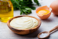 Homemade mayonnaise, mayo in a wooden bowl. White background Stock Photo