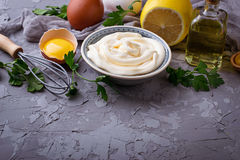 Homemade mayonnaise sauce and olive oil, eggs, mustard, lemon Royalty Free Stock Photo