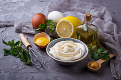 Homemade mayonnaise sauce and olive oil, eggs, mustard, lemon. Selective focus royalty free stock image