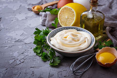 Homemade mayonnaise sauce and olive oil, eggs, mustard, lemon Stock Photo
