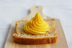 Homemade mayonnaise on a slice of integral bread Stock Photos