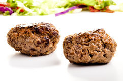 Homemade meat balls and salad in the background Royalty Free Stock Photography