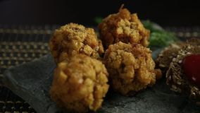 Homemade meat cutlets in batter with parsley, ketchup and bread on stone stock footage