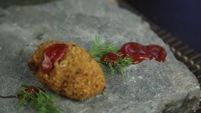 Homemade meat cutlets with parsley on stone, poured over food ketchup stock video footage