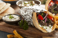Homemade Meat Gyro with French Fries Stock Image