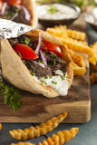 Homemade Meat Gyro with French Fries Royalty Free Stock Photo