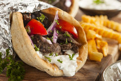 Homemade Meat Gyro with French Fries. Homemade Meat Gyro with Tzatziki Sauce, tomatos and French Fries Stock Images