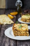 Homemade meat lasagna on wooden table stock photo