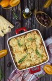 Homemade meat lasagna on wooden table royalty free stock image