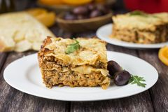 Homemade meat lasagna on wooden table stock photography