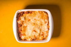 Homemade Meat lasagna on wooden yellow table top view Royalty Free Stock Photos