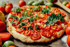 Homemade Meat Loves Pizza with Pepperoni Sausage and Bacon. Home Royalty Free Stock Image