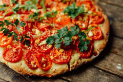 Homemade Meat Loves Pizza with Pepperoni Sausage and Bacon. Home Stock Photography