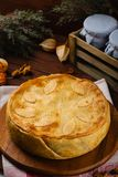 Homemade meat pie decorated with fall leaves Royalty Free Stock Image