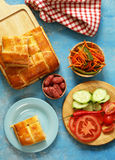Homemade meat pie for lunch, with salad Stock Images