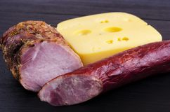 Homemade meat, sausage and cheese on a dark background stock photo
