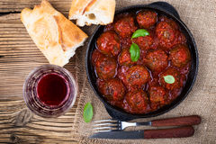 Homemade meatball in frying pan on  rustic wooden table,top view Stock Photos