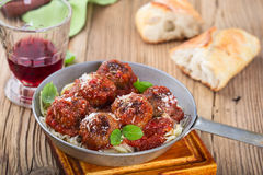 Homemade meatball with Italian pasta in frying pan on  rustic wo Royalty Free Stock Images