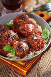 Homemade meatball with Italian pasta in frying pan on  rustic wo Royalty Free Stock Photos