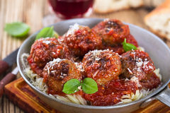 Homemade meatball with Italian pasta in frying pan on  rustic wo Royalty Free Stock Photography
