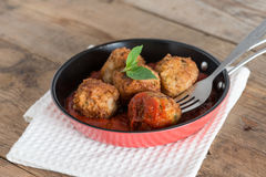 Homemade, Meatball with tomato sauce in pan. Selective focus. Royalty Free Stock Image