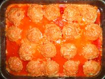 Homemade meatballs in sauce on a baking sheet stock photo