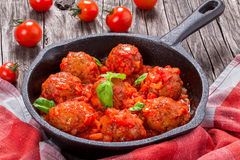 Homemade meatballs smothered in a marinara tomato sauce, close-u Stock Photography