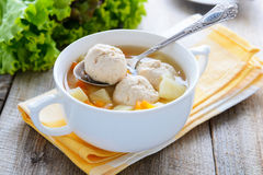 Homemade meatballs soup on yellow tablecloth Royalty Free Stock Photography
