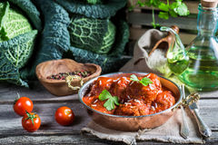 Homemade meatballs with tomato sauce and cabbage Stock Photography