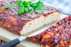 Homemade meatloaf with ketchup and parsley Royalty Free Stock Photography