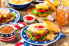 Homemade Memorial Day Hamburger Picnic. With Chips and Fruit royalty free stock photo