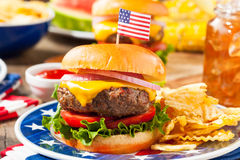 Homemade Memorial Day Hamburger Picnic. With Chips and Fruit Stock Photography