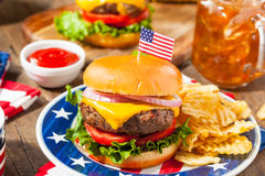 Homemade Memorial Day Hamburger Picnic. With Chips and Fruit Stock Image
