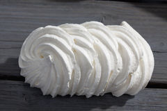 Homemade meringue cookies on wooden table close up Royalty Free Stock Photos