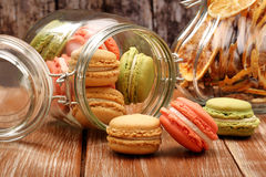 Homemade meringue macaroons in the jar on wooden background Royalty Free Stock Photography